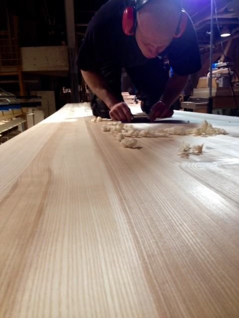 Master wood-craftsmen putting the last touch to a EDI table by Claesson Koivisto Rune in the NIKARI factory in Fiskars, Finland.