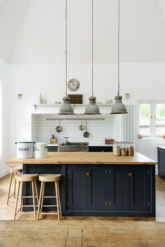 Kitchen island inspiration, with seating around corner, blue traditional doors and timber benchtop - Found on Pinterest