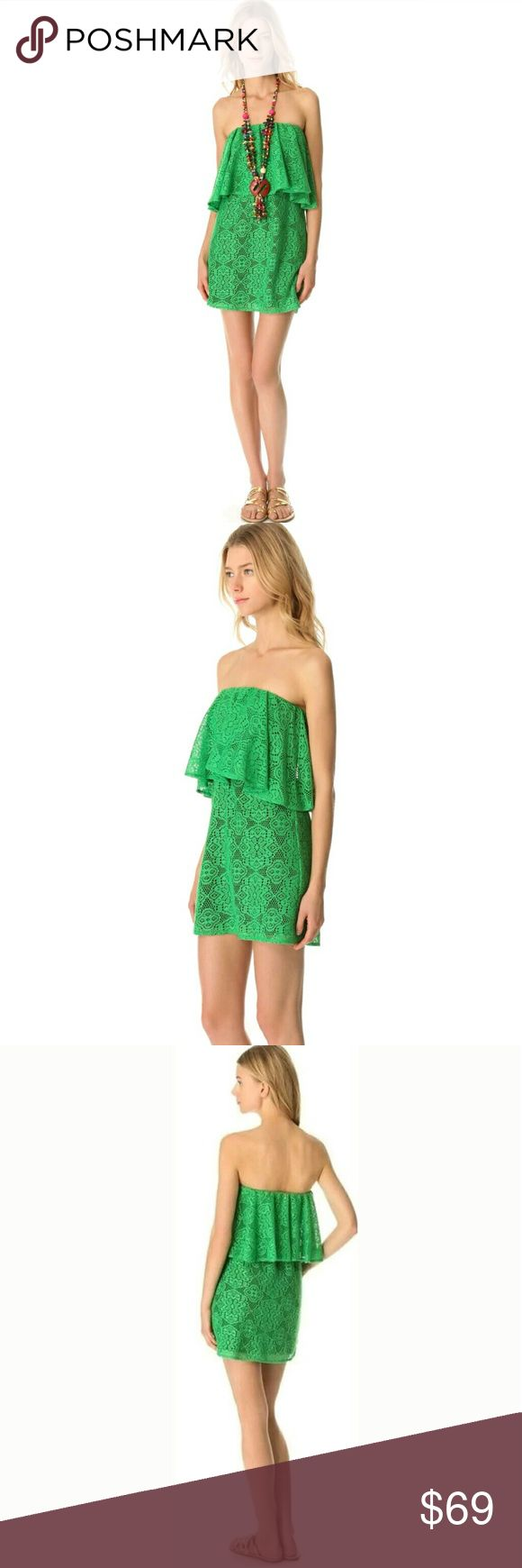 """T-BAGS Los Angeles green lace mini ruffle dress New. No tags.   A cheery, playful & flirty lace dress. Gathered elastic secures the strapless top hem which is detailed with a lush ruffle overlay & smocked elastic curves around the waist. Contrast lining pops against the floral pattern  Model: Misa Shell: 100% Viscose Lining: 96% Venezia 4% Spandex stretchy comes with necklace dry clean Made in the USA  Approx Measurements Length: 24"""" Bust: 13.25"""" Waist: 10"""" Hips: 18.5"""" T-Bags Dresses Mini"""
