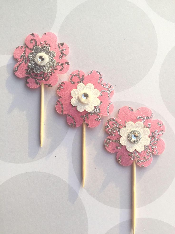 A personal favourite from my Etsy shop https://www.etsy.com/uk/listing/532714032/pink-flower-toppers-pink-cupcake