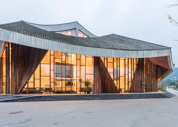 A glass walkway wraps a steamy geothermal pool at the heart of this spa resort in rural China.