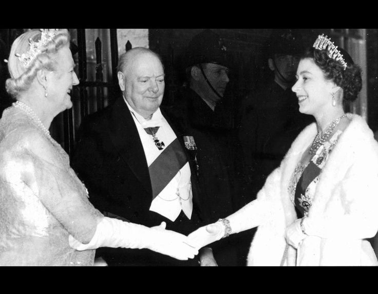 The Queen shaking hands with Clementine Churchill watched by Sir Winston Churchill [EXPRESS NEWSPAPERS]