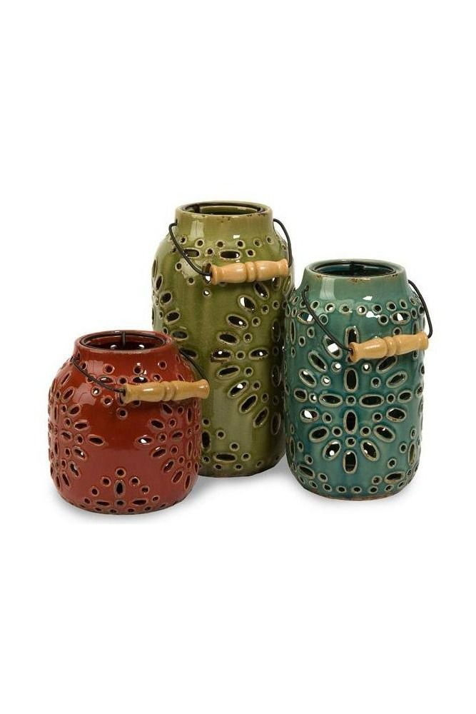 This set includes three outdoor lanterns in muted shades of red, green and blue. Each lantern has a removable candle holder. These would be a lovely addition to a deck, patio or front porch.