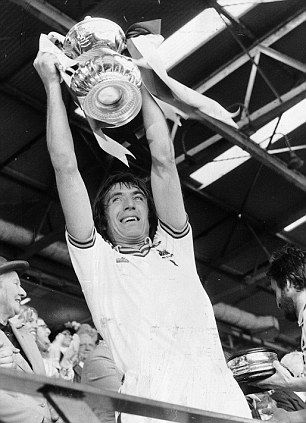 Billy Bonds lifts the FA Cup after Second Division West Ham have beaten Arsenal of the First Division 1-0 at Wembley on May 10, 1980