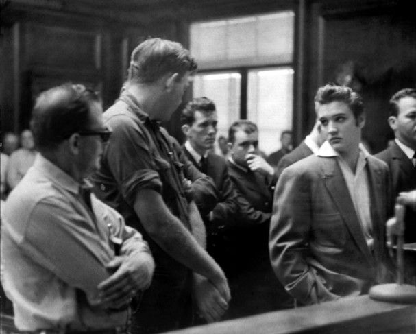 Elvis Presley in a Memphis city court on Oct. 19, 1956, along with Gulf service station employees Edd Hopper (left) and Aubrey Brown. The trio had a fight the previous night when Elvis pulled into the station at Gayoso and Second for repairs and was besieged by fans. Hopper, the station manager, ordered Presley away and a brief altercation ensued.  All three were booked for assault and battery and disorderly conduct. Charges against Presley were dismissed. Hopper and Brown both had to pay…
