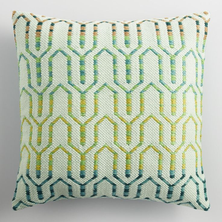 Our textured throw pillow recalls the look of woven rugs with its chic geometric pattern in cool tones embellished with embroidery and yarn detail. Crafted using thread derived from recycled plastic bottles, it's just right for outdoor or indoor spaces.