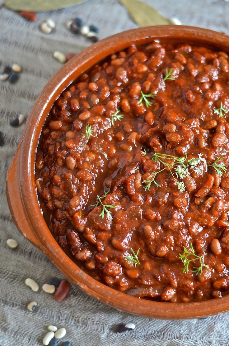 These thick, sweet & smoky slow cooked vegan barbecue baked beans can be made in a slow cooker or on a stove top. Comforting & full of complex flavours.