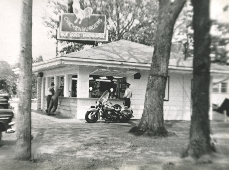 An RCMP officer stops by the Chick for a Chickenburger in 1956.