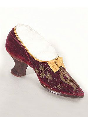 "French velvet shoes with metallic embroidery and silk ribbon bows, c.1880. The soles are stamped ""Pou-Matero."""