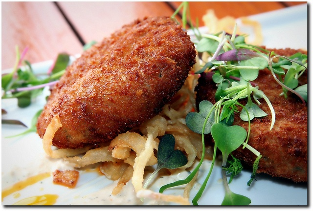 Sweet Crab Cakes on a bed of Maui Onion rings - Rio City Cafe, Old Town Sacramento