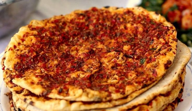 Hatay Mutfağı  Biberli Ekmek. Turkish bread with red pepper paste, cheese and spices, from the region of Hatay.