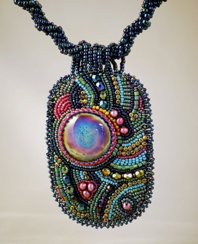 Cab made by Robert Simmons from Striking Color glass; beadwork by Camille Simmons. Lovely!!
