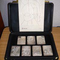 """REBAJADO LOS """"SIETE DÍAS DE LA CREACIÓN"""", diseño de Salvador Dalí Año 1979 Plata fina de 999/0000 7 cuadros de plata fina de8 x6 cm Peso de 125 gr por cada lingote de plata fina = total 875 gr Con certificado de autenticidad"""