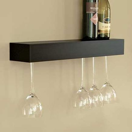 I think this is a good idea to double space in a cupboard This would work for more than just wine glasses (Which I don't use) but anything with a lip.