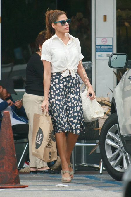 "Eva Mendes has been spotted absolutely everywhere in her vintage-inspired blue ""Obsessy"" sunnies--are these outfit-makers, or what? You can score your own for $368 at eyegoodies.com."