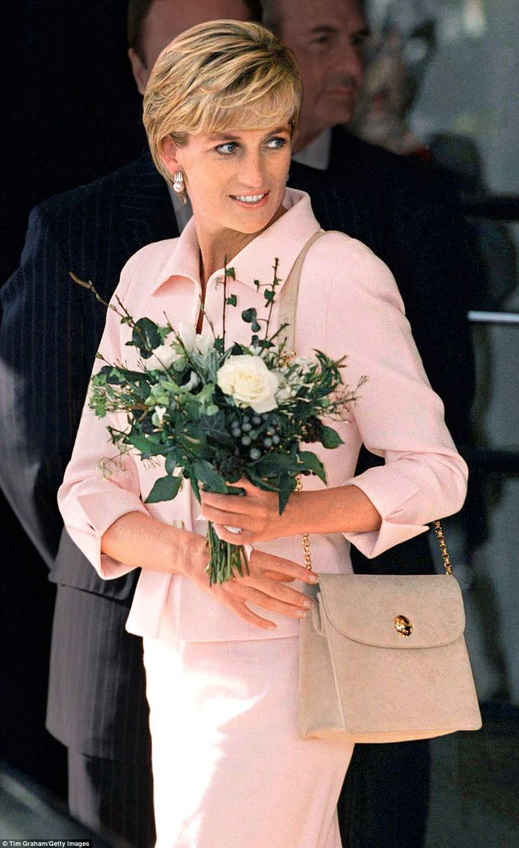 Bags of style: Diana's Versace tote goes perfectly with a pink Catherine Walker suit at an awards ceremony at The Savoy