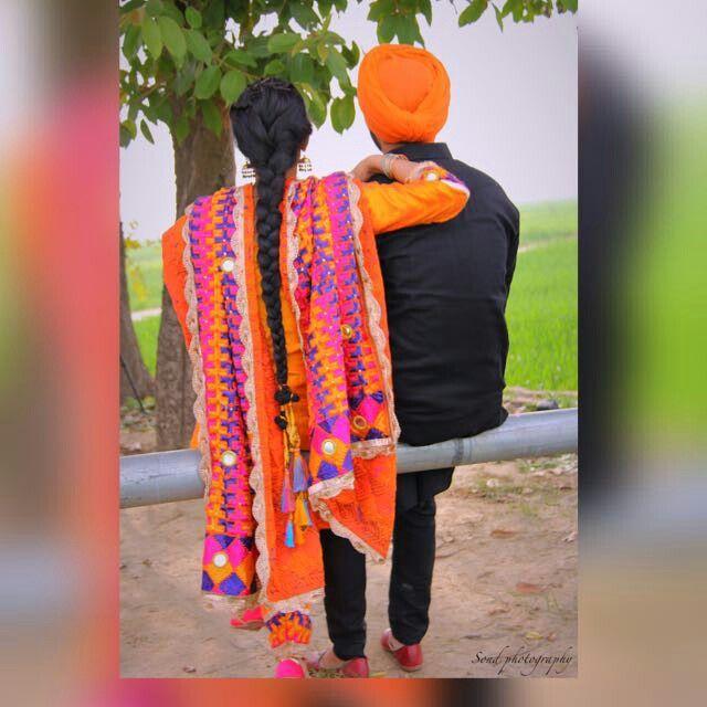 Punjabi Couple Holding...