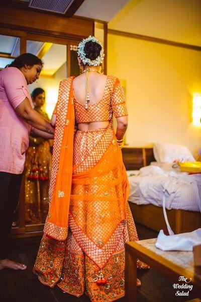 Bridal Wear - Orange Wedding Lehenga | WedMeGood | Orange Lehenga with Orange Choli with Silver and Gold Embroidery, Orange Net Dupatta  #wedmegood #indainbride #indianwedding #lehenga #dupatta #net #orange #gajra