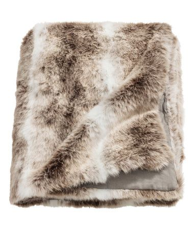 $79.99 White/light brown. Blanket with faux fur at front and solid-color cotton canvas at back.