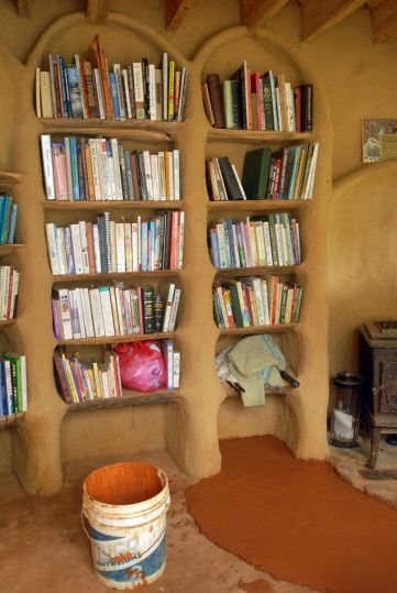 I hope our Earthen cob house is lined with full bookshelves! Books are the one thing I could never be green about. :/