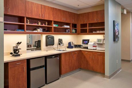 Nice example of under-counter frig in lab area with a pass-thru to reception
