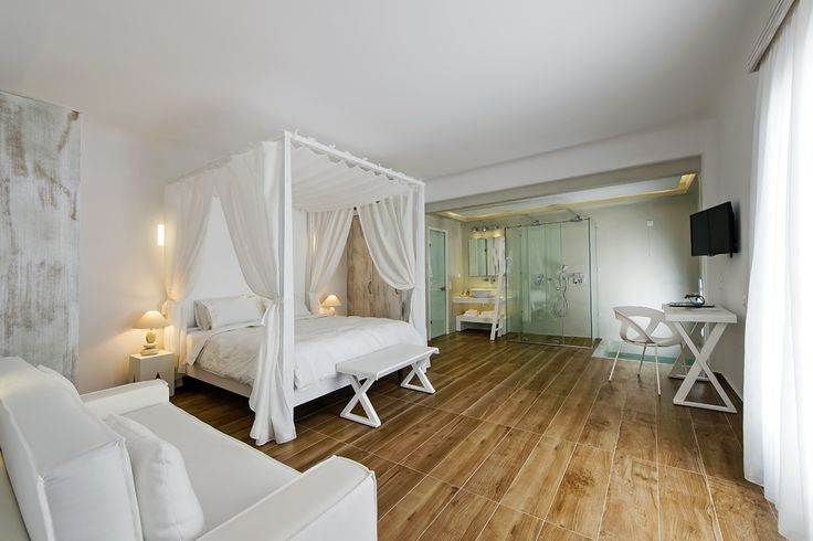 Welcome to your ultimate #honeymoon cocoon!  The Cavo Bianco Honeymoon Suite is a beautifully designed double bedroom with canopy bed, sitting area, open plan bathroom with double size glass shower, an indoor Jacuzzi and a private balcony, all for making those special memories!  www.cavobianco.com