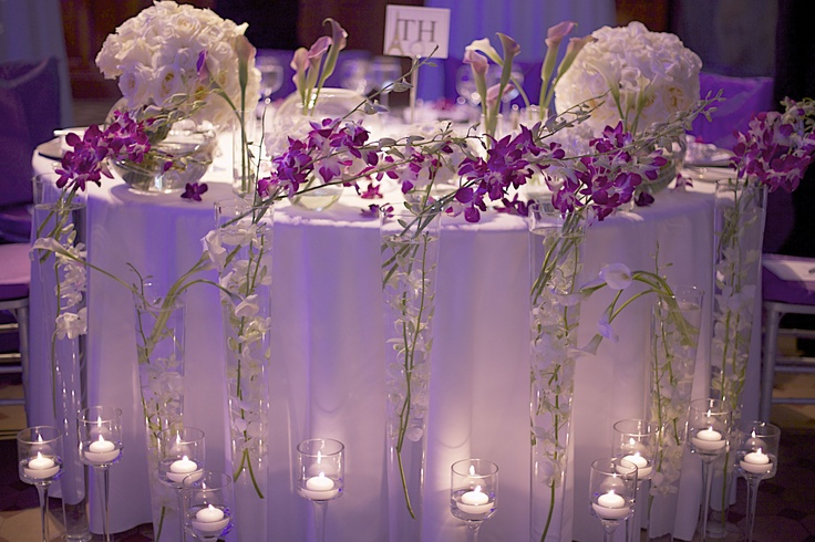 Sweetheart table; love the floor decor of candleholders and tall vases