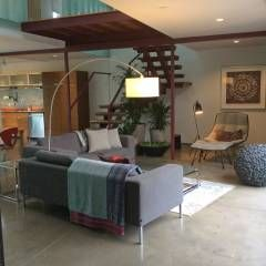 Living room : modern Living room by Ecosa Institute