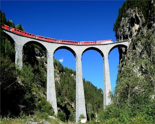 LANDWASSER VIADUCT The Landwasser Viaduct (German: Landwasserviadukt) is a single track six-arched curved limestone railway viaduct. It spans the Landwasser River between Schmitten and Filisur, in the Canton of Graubünden, Switzerland.