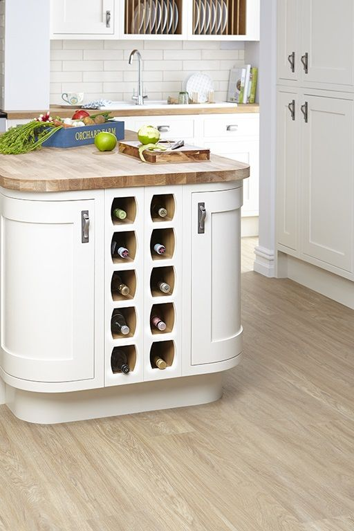 Don't forget to utilise every space when designing your neutral kitchen. Built-in wine racks are not only incredibly practical, but they also make an attractive design feature too.