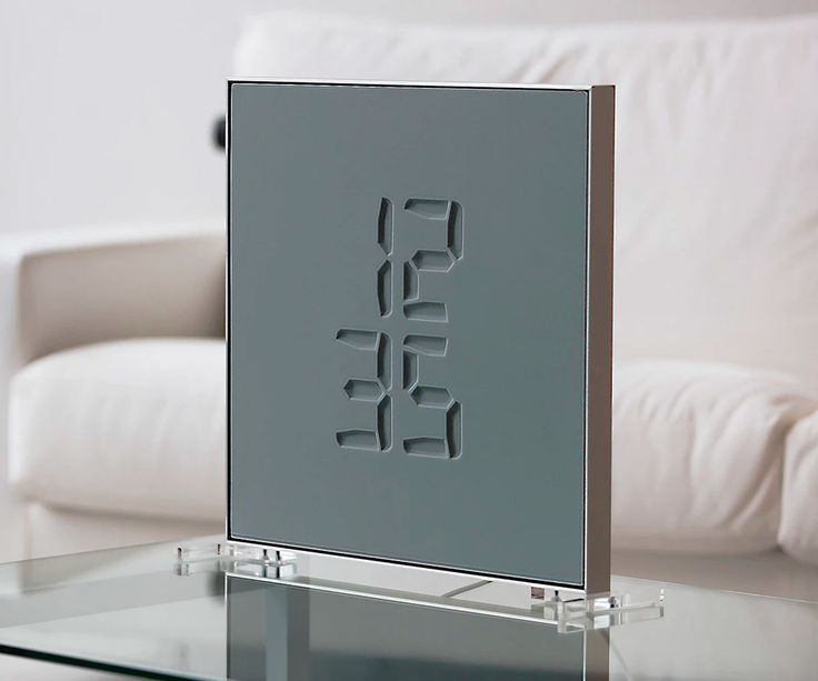 The Etch clock engraves every minute of your day into stone. Figuratively speaking. Really it uses the trickery of 3D digital numbers and a colored elastic membrane to give the eye-catching appearance of chiseled time. Then Etch turns eye-catching in