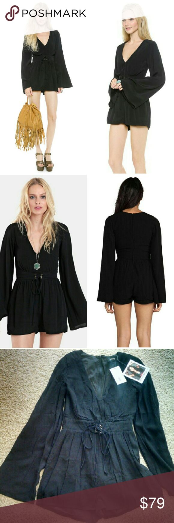 """MinkPink Follow Me to Heaven Playsuit NWT MinkPink Follow Me to Heaven Black Playsuit. Size s Retail $89+tax  Lace up waist detail. great bell sleeves. Back zip.  New w tag, unworn, only tried on. A bit wrinkled, Could use steam/iron & I'm without my steamer. 2"""" inseam. Lined. Hippie boho festival witchy woman cuteness. Last pic 5'8"""" size 4. Tags romper, nasty gal, urban outfitters MINKPINK Pants Jumpsuits & Rompers"""