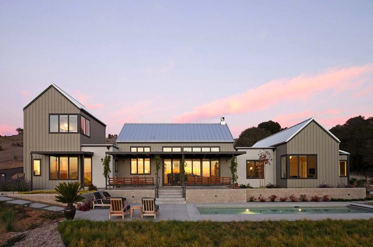 A modern farmhouse was designed by Gast Architects for a retired couple, nestled on rolling hills near the coast, just outside of Arroyo Grande, California.