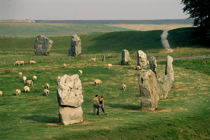 Part of Avebury Stone Circle in Avebury, Wiltshire, England;  the stones date back to around 2500 BC, the same time as nearby Stonehenge;  Avebury contains the largest stone circle in Europe, and within that circle are two smaller circles;  there are over 100 remaining stones;  Avebury is 16 times larger than Stonehenge