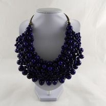 Beautiful handmade necklace wooden beads roped statement necklace.