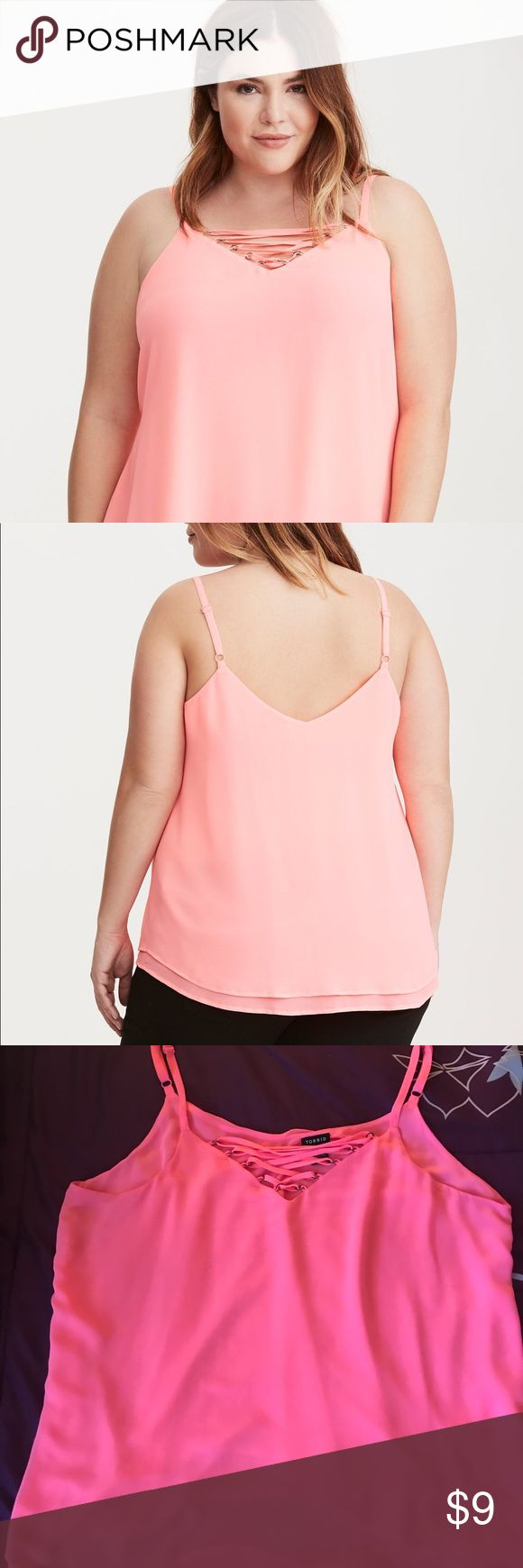 Pink Strappy Front Double Layered Chiffon Cami Two floaty, semi-sheer, and swingy neon pink chiffon layers, strappy crisscross v-neck, detailed with silver tone o-rings. Bought for $38.98 but is now on Torrid's website for $19.59. torrid Tops Camisoles