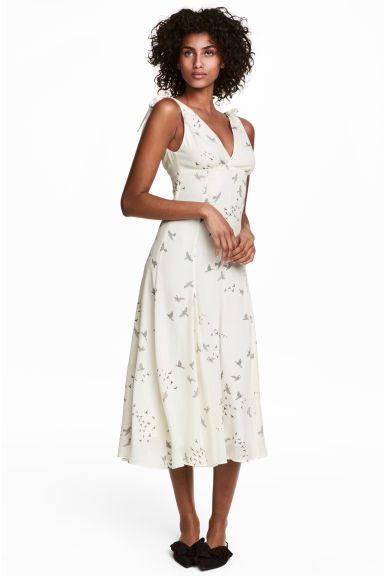 e3afd3f27749 Šaty s výstřihem do V Model