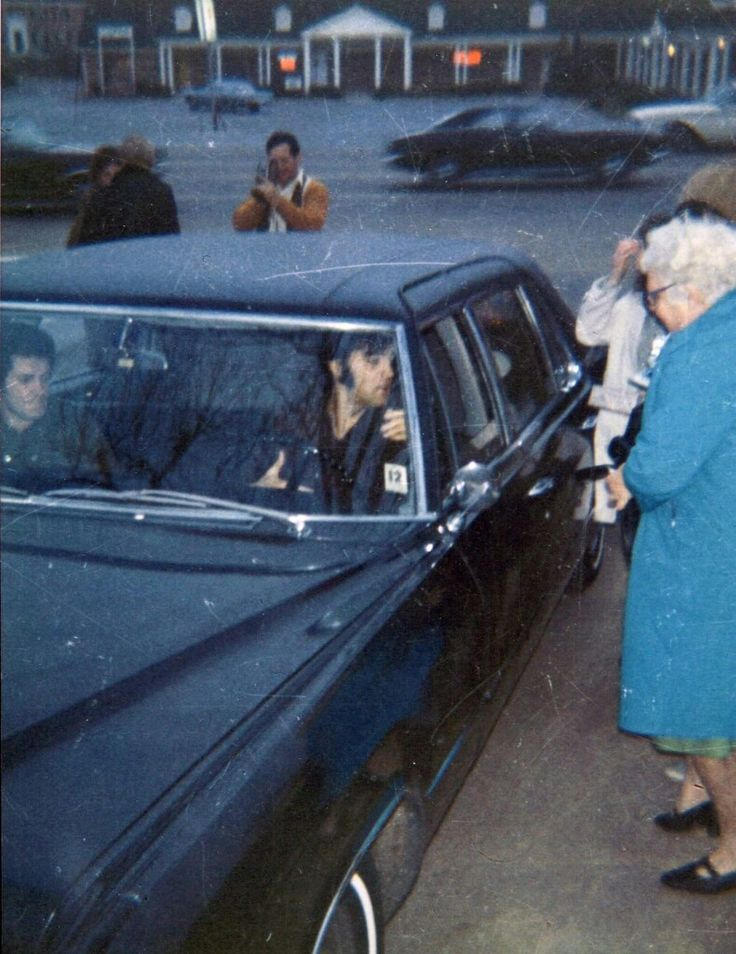Cool rare shot of Elvis driving his 1967 Cadillac Fleetwood Series 75  into Graceland......1969/1970......