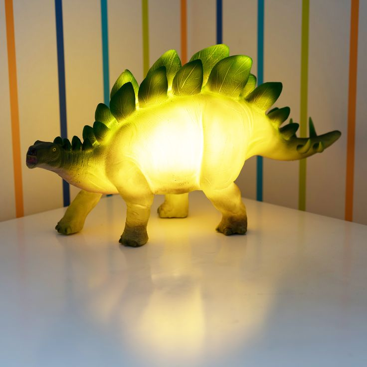 Add some pre-historic fun to a child's bedroom with this Stegosaurus table lamp that emits a warm welcoming glow. A perfect companion for a bedside table  This is even great for the dinosaur lover's out there, especially to accessorise an office or study  Requires 2 x AAA batteries (not included)   It's also a fun gift for kids