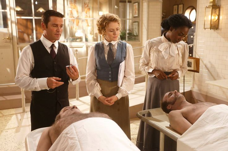 Detective Murdoch (Yannick Bisson) watches as Dr. Ogden and Rebecca James work in the morgue.