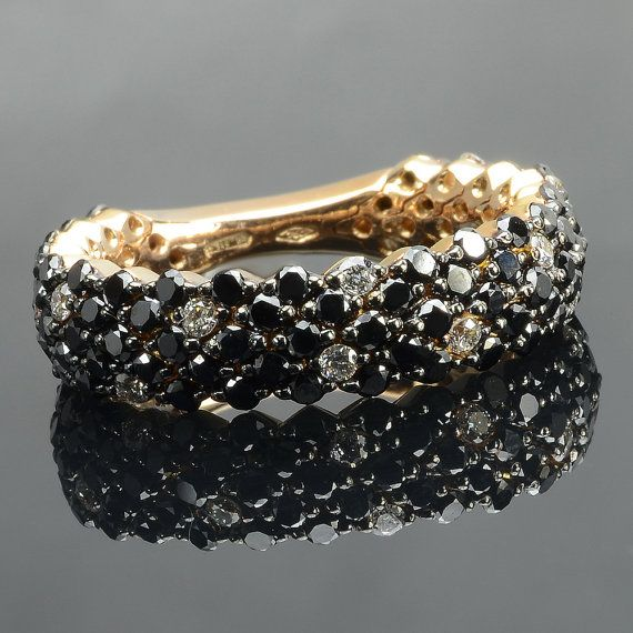 Ring in 18 kt rose gold with natural brilliant-cut black diamonds of 0,1,61 ct and white diamonds of 0,22 ct. The #ring is available in yellow gold, white gold but you can also customize carats, quality, and color of #gemstones. All our #jewelry are made in italy. Contact us for any particular request.