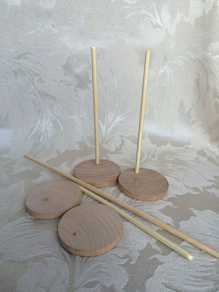 Doll Stands.  Wooden Circle, Bamboo Barbecue sticks, glue!  Done
