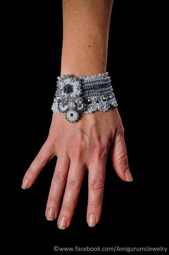 This unique cuff is a handmade item. It is crochet from microfiber thread and its decorated with crochet flower and lots of glass seed beads in