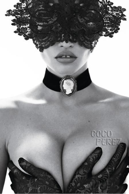 October 2010   With her face hidden behind a black lace and crystal headpiece by Philip Treacy, Lara Stone celebrated 90 years of Vogue Paris in a black and white editorial shot by photographers Mert Alas & Marcus Piggott. The Dutch model is immediately recognizable, with her ample curves and full lips.