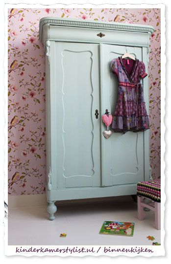 Pretty pale green armoire for a girl's room. Love the bird wallpaper print too…