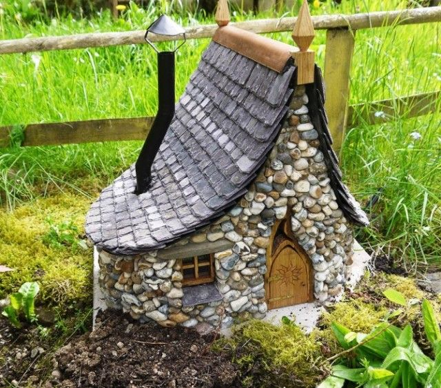 Miniature Stone Fairy Houses - Made with Bottles, Stones, Grout, and a little imagination.
