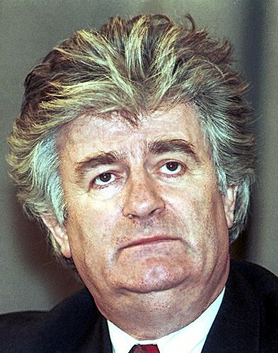 Radovan Karadžić - bosnia based, serbian war criminal. Currently in Hague, since 2008, where they don't seem to be able to convict him and get it over with. He wasn't arrested by serbian police, but rather by people who discovered his identity. His crimes include genocide of #Srebrenica and  war crimes at siege of Sarajevo https://en.wikipedia.org/wiki/Radovan_Karad%C5%BEi%C4%87