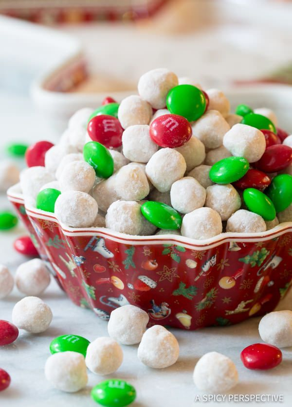 Snowball Party Mix Recipe, a fun and festive holiday snack mix that makes a marvelous edible gift idea! Made with Christmas M&Ms, Kix cereal, cinnamon,