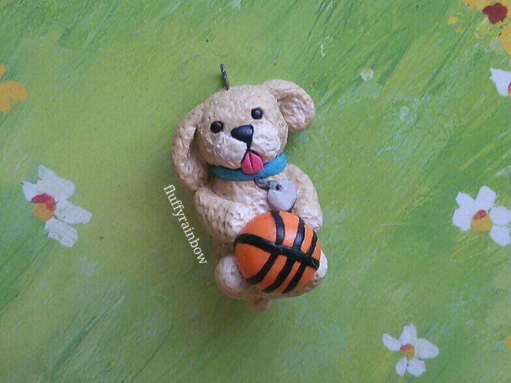 Puppy playing basketball