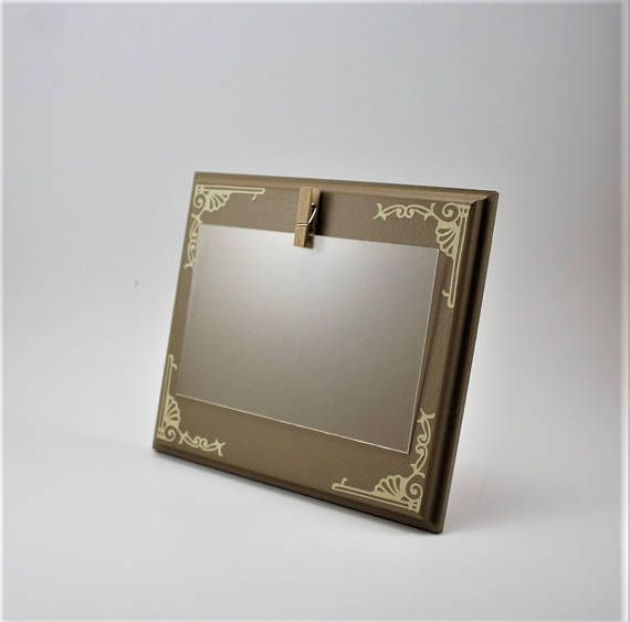 clip picture frame 4 x 6 picture frame brown picture frame small picture frame custom picture frame brown picture frame wood frame  This is a fun pictures frame to show off your pictures. This picture frame is 6 3/4 by 7 3/4 by 1/2 thick. The sides have been routered to give it a unique look. It holds a 4 x 6 picture. The frame shown here is # 7 Toffee Brown with Cream designs in the corners. It is available in different colors, please choose one when ordering. Picture is held ...